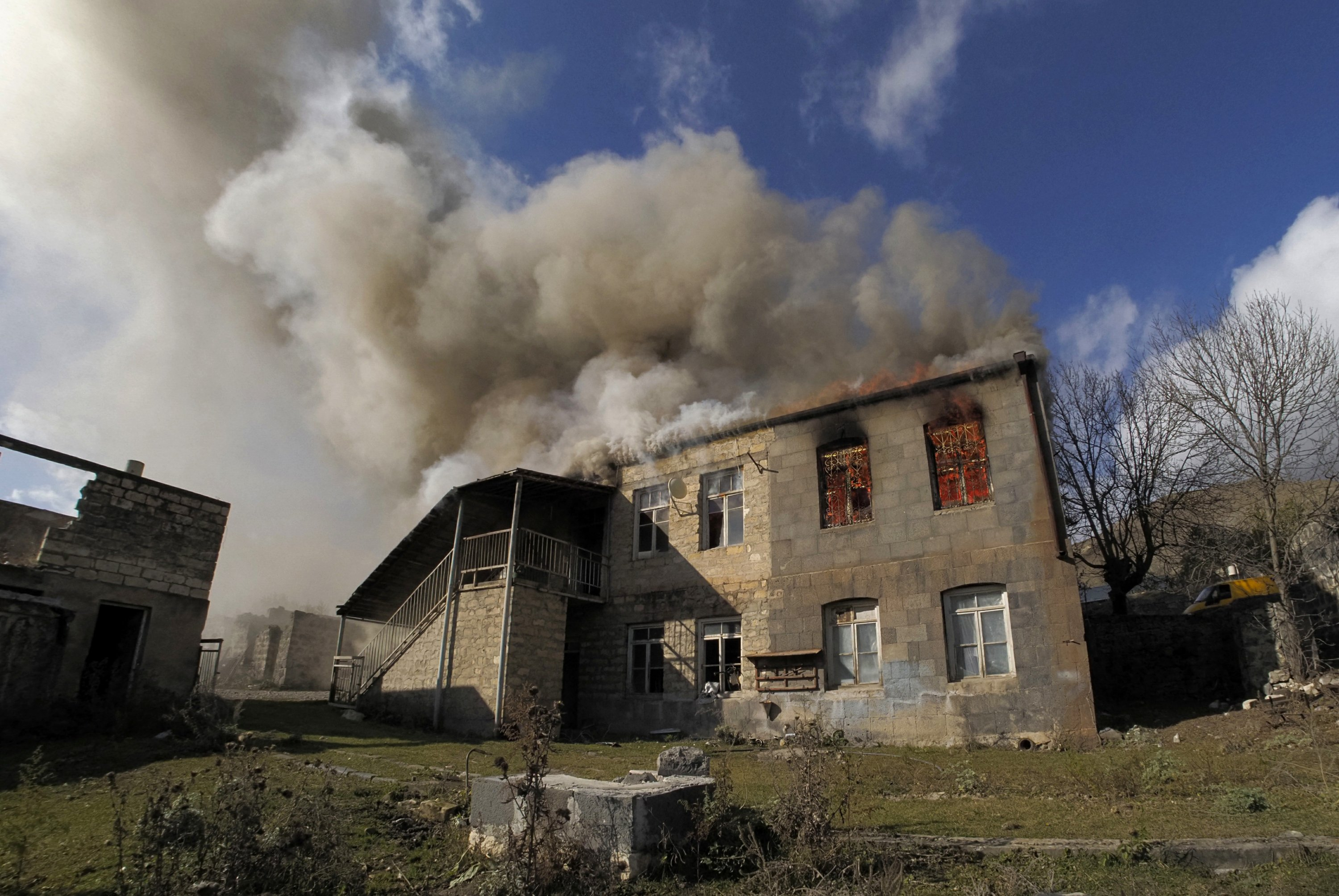 Armenians torch their homes on land ceded to Azerbaijan – The Associated Press