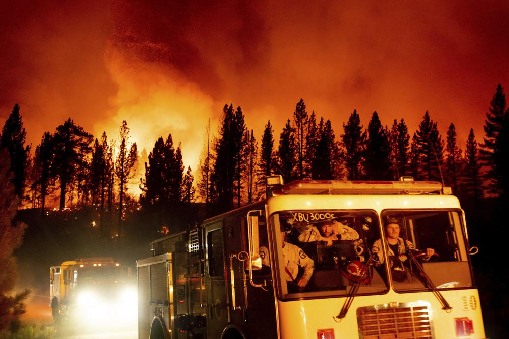 Firefighters arrive at Frenchman Lake to battle the Sugar Fire, part of the Beckwourth Complex Fire burning in Plumas National Forest, Calif., on Thursday, July 8, 2021. (AP Photo/Noah Berger)