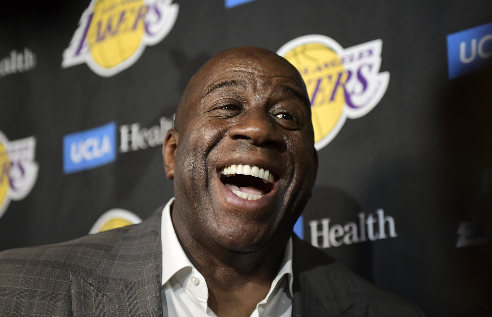 Without basketball, Magic Johnson shifts focus to community