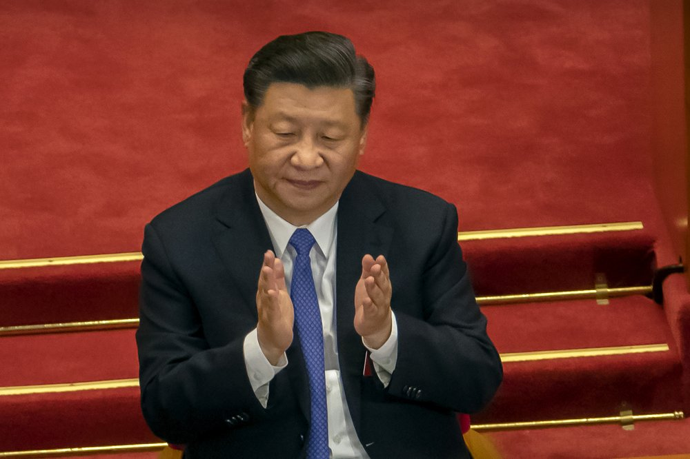 Praising President Xi Jinping's role, China celebrates official end of extreme poverty