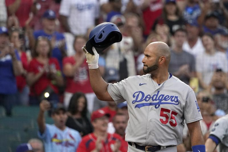 Los Angeles Dodgers' Albert Pujols tips his tap to cheering fans as he steps up to bat during the first inning of a baseball game against the St. Louis Cardinals Tuesday, Sept. 7, 2021, in St. Louis. (AP Photo/Jeff Roberson)
