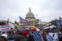 FILE - In this Jan. 6, 2021, file photo insurrections loyal to President Donald Trump rally at the U.S. Capitol in Washington. A federal judge held the director of the District of Columbia's Department of Corrections and the warden of the city's jail in contempt of court on Wednesday, Oct. 13, and asked the Justice Department to investigate whether the civil rights of inmates are being abused. U.S. District Judge Royce Lamberth had hauled the jail officials into court as part of the criminal case into Christopher Worrell, a member of the Proud Boys who has been charged in the Jan. 6 attack at the U.S. Capitol. (AP Photo/Jose Luis Magana, File)