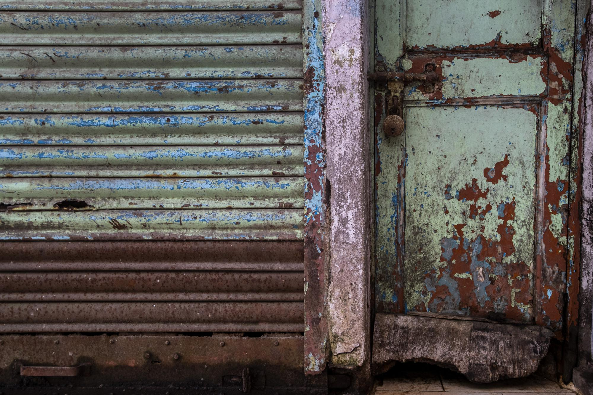 A shop is seen locked at a market area in Gauhati, India, on June 18, 2021. Rows of locked shops confront bargain-hunters for most of the day in Fancy Bazar, a nearly 200-year-old market that offered cheap prices until the COVID-19 pandemic hit Gauhati, the biggest city in India's remote northeast. (AP Photo/Anupam Nath)