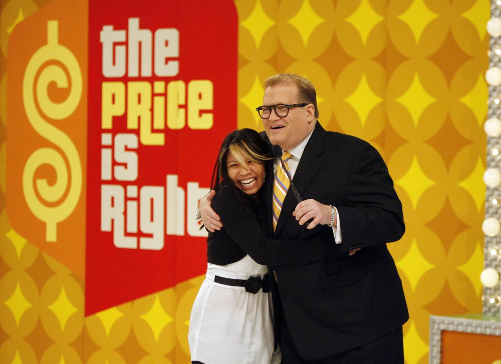 """This image released by CBS shows host Drew Carey, right, with contestant Carmie Fortunato on the set of """"The Price is Right"""" in Los Angeles on Feb. 20, 2008. The longest-running game show in television history is celebrating it's 50th season. (Mark Davis/CBS via AP)"""