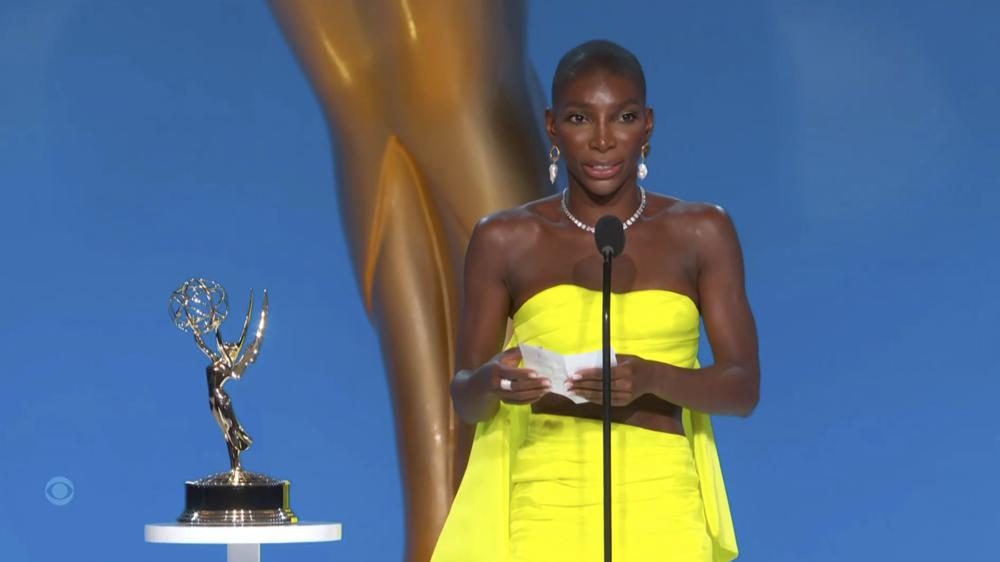 """In this video grab issued Sunday, Sept. 19, 2021, by the Television Academy, Michaela Coel accepts the award for outstanding writing for a limited or anthology series or movie for """"I May Destroy You"""" during the Primetime Emmy Awards. (Television Academy via AP)"""