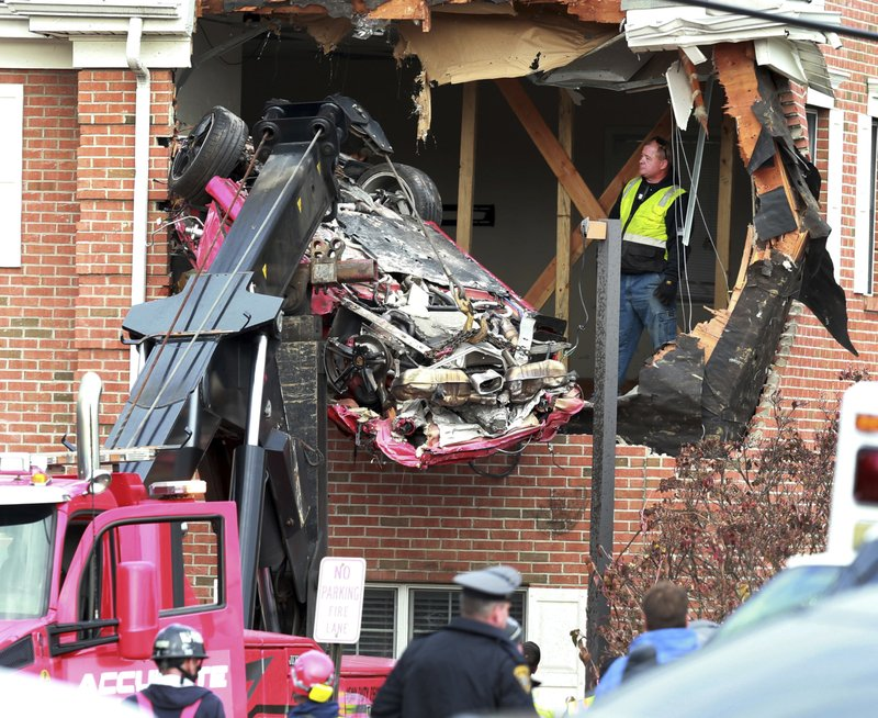 2 dead after Porsche crashes into building\u0027s 2nd floor