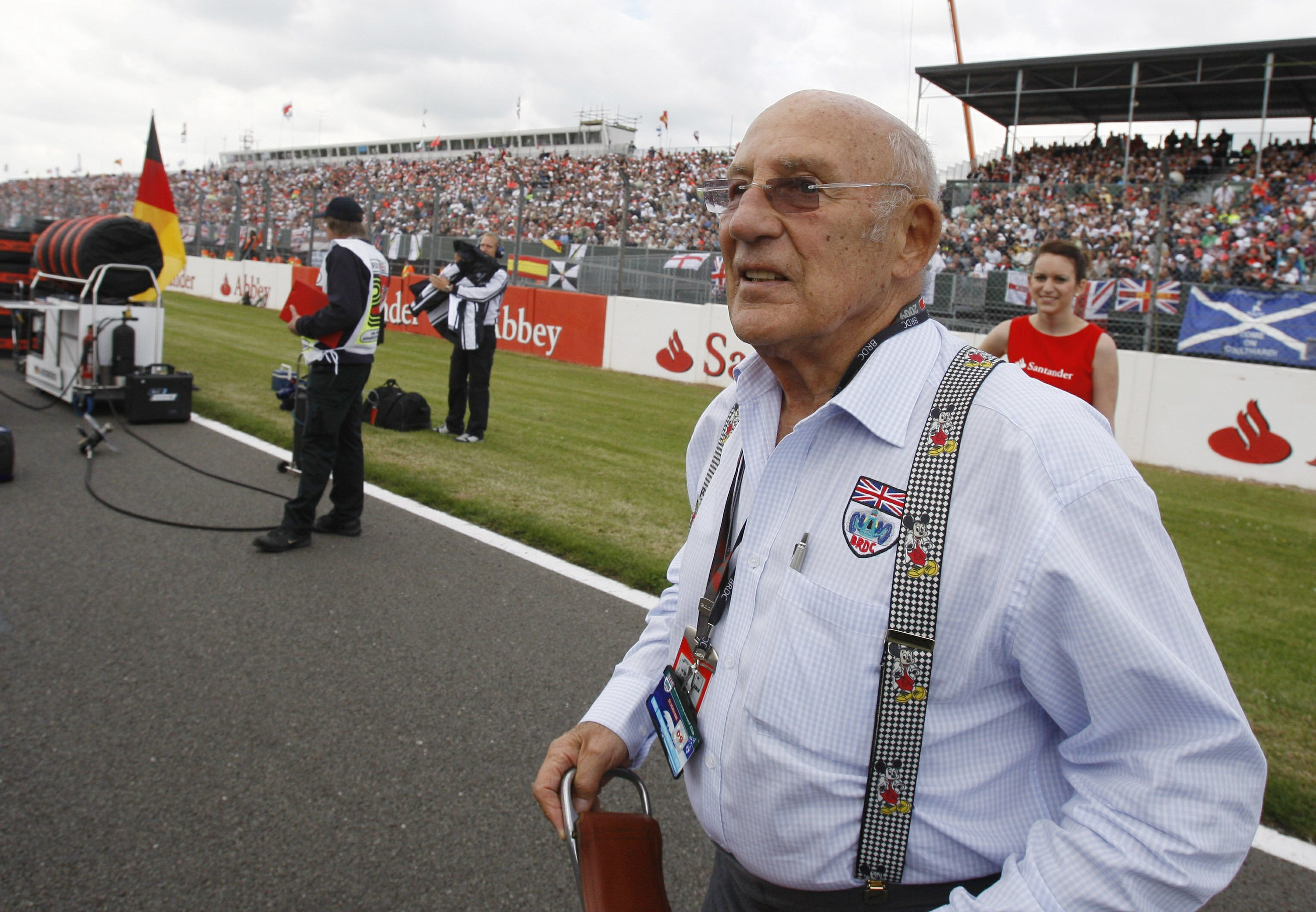 Motor racing great Stirling Moss dies aged 90