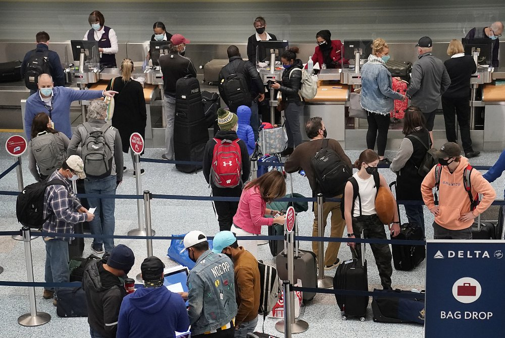 Travelers try to reach destinations in time for Thanksgiving, miss virus