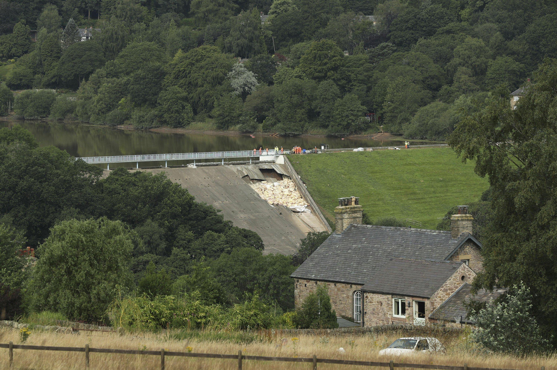 Crews race to ease pressure on damaged UK dam as rain looms