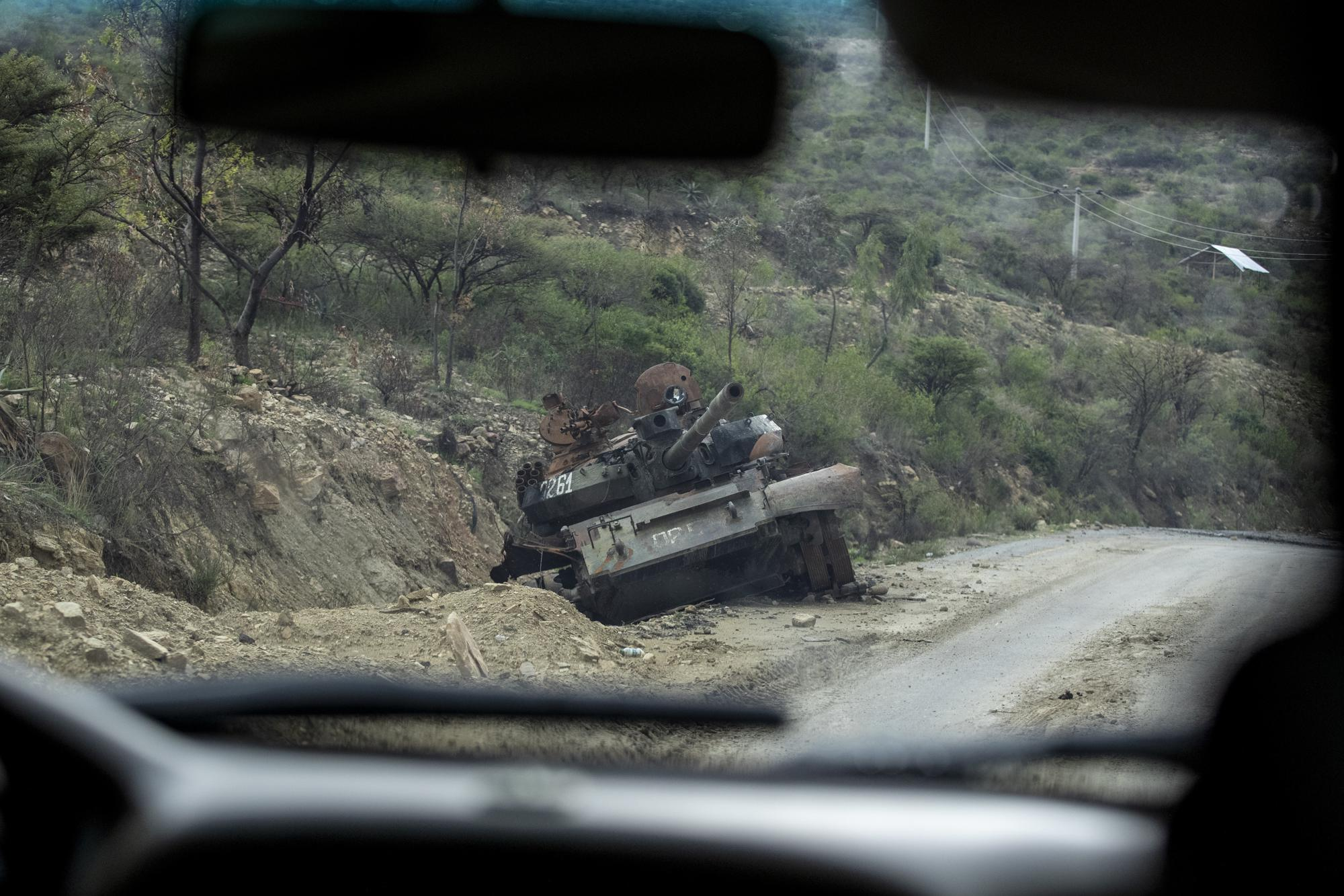 A destroyed tank sits by the side of a road leading to Abi Adi, in the Tigray region of northern Ethiopia, on Tuesday, May 11, 2021. The Tigray People's Liberation Front was on top of a coalition that ruled Ethiopia for nearly three decades. That changed in 2018, when Prime Minister Abiy Ahmed rose to power as a reformist. Abiy alienated the TPLF with efforts to make peace with its archenemy, Eritrea, and rid the federal government of corruption. (AP Photo/Ben Curtis)