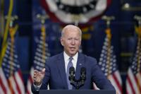 In this Oct. 25, 2021, photo, President Joe Biden speaks at NJ Transit Meadowlands Maintenance Complex to promote his economic agenda in Kearny, N.J. Biden promised to show the world that democracies can work to meet the challenges of the 21st century. As he prepares to push that message at a pair of global summits, Biden's case could hinge on what's happening in Washington, where he is scrambling to finalize a major domestic legislative package. (AP Photo/Evan Vucci)