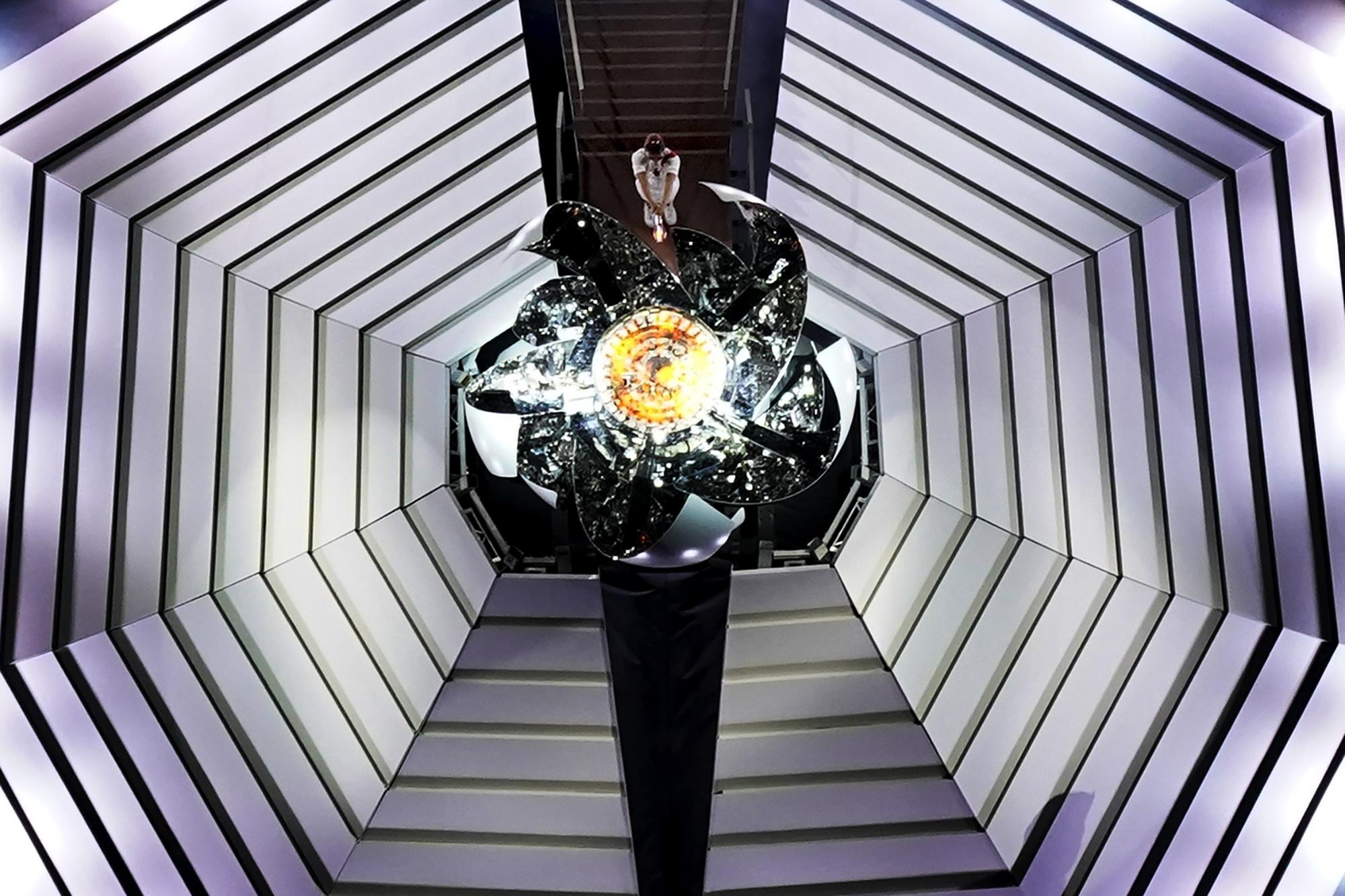 Naomi Osaka lights the Olympic cauldron during the opening ceremony at the Olympic Stadium at the 2020 Summer Olympics, Friday, July 23, 2021, in Tokyo. (AP Photo/Morry Gash)