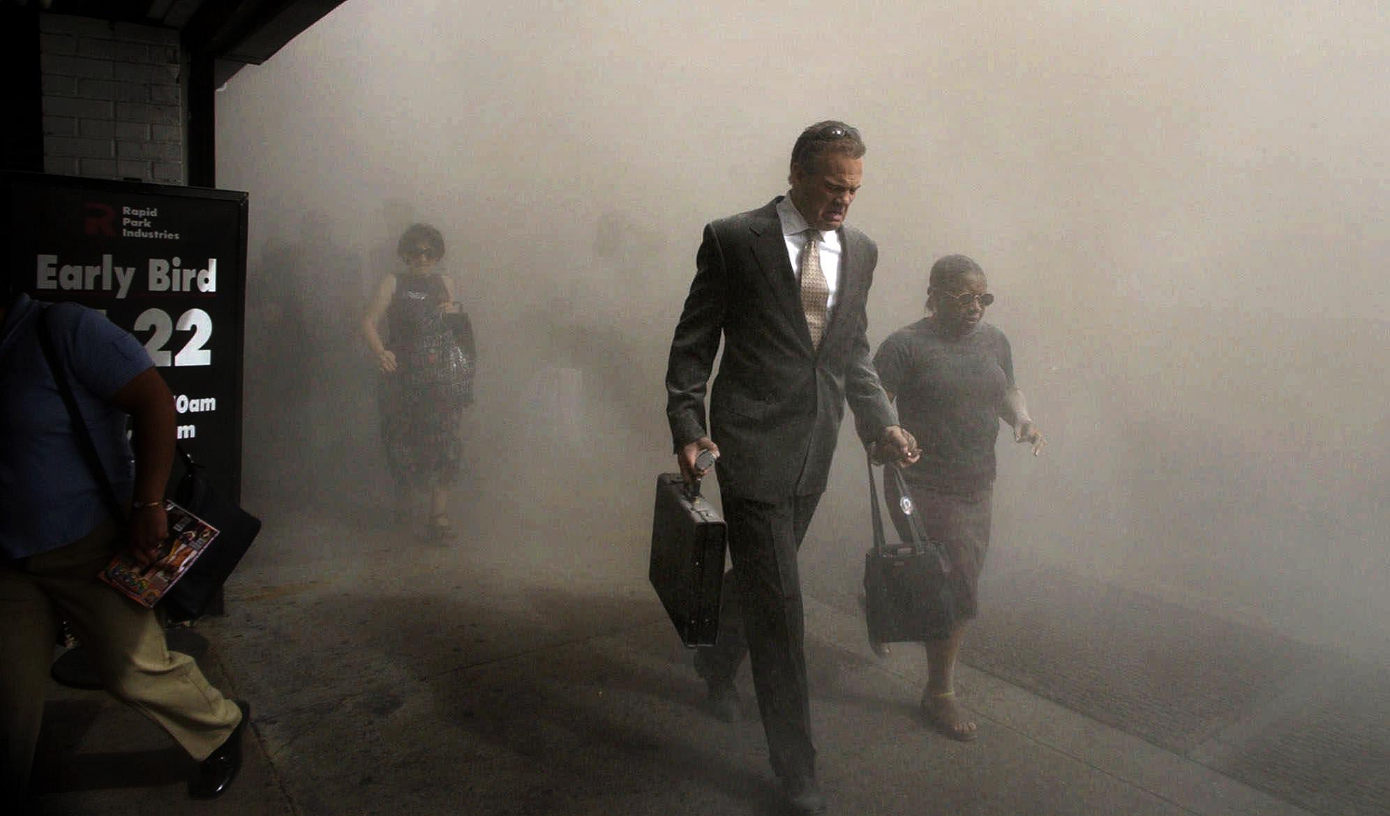 Pedestrians flee the area of New York's World Trade Center in lower Manhattan on Tuesday, Sept. 11, 2001. (AP Photo/Amy Sancetta)