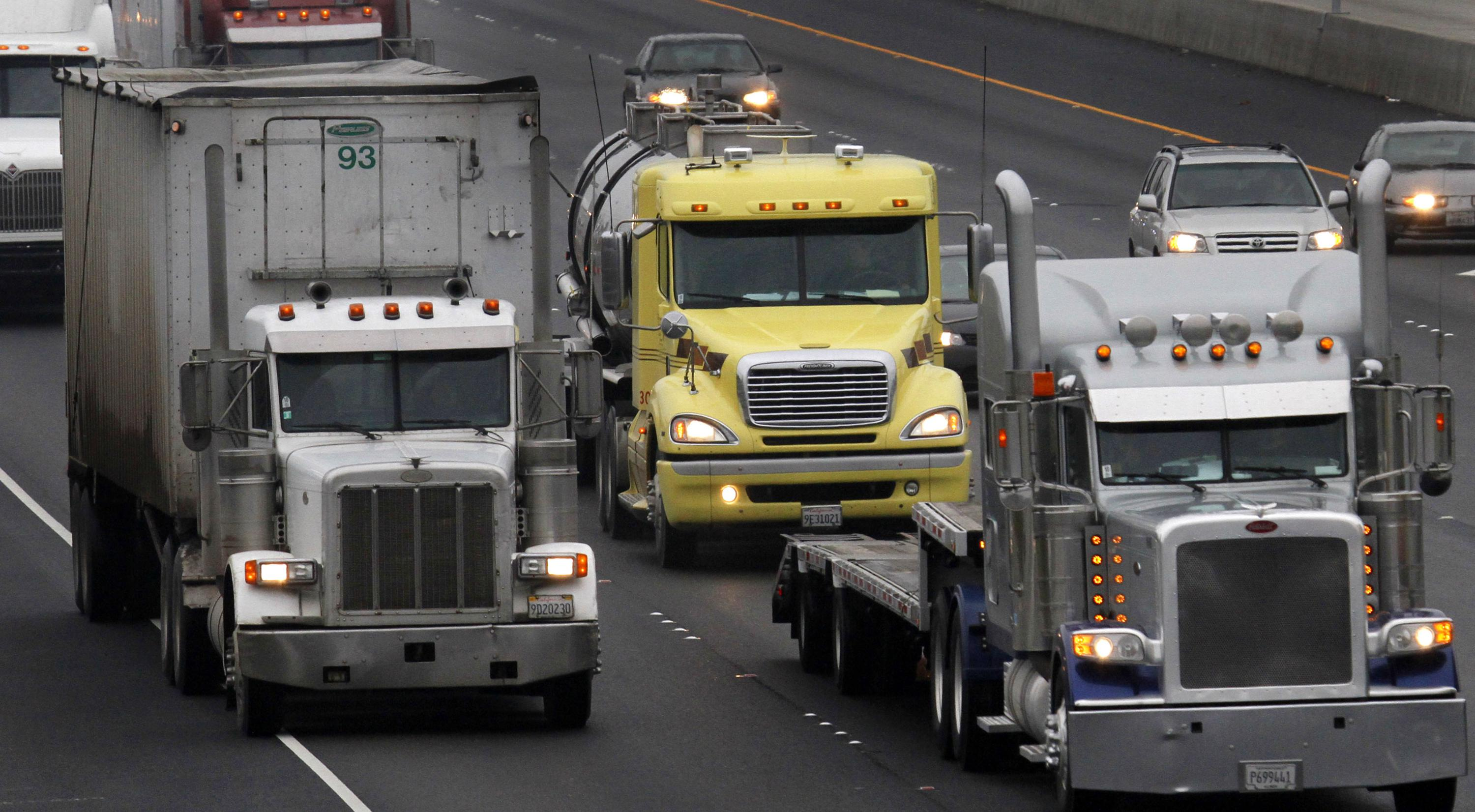 BOSTON (AP) — Officials from companies with fleets of trucks are urging governors across the country to embrace a rule meant to speed the adoption o