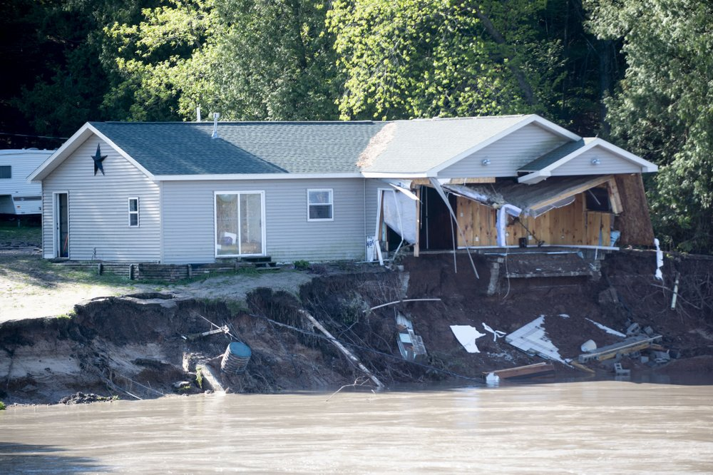 Floodwaters have overtaken dams and forced the evacuation of about 10,000 people in central Michigan