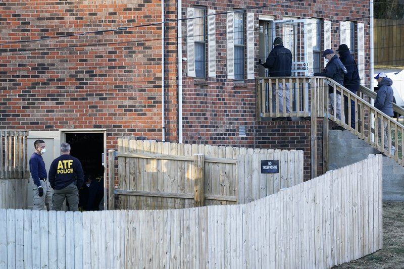 FBI and ATF agents investigate a home Saturday, Dec. 26, 2020, in Nashville, Tenn. An explosion that shook the largely deserted streets of downtown Nashville early Christmas morning shattered windows, damaged buildings, and wounded three people. Authorities said they believed the blast was intentional. (AP Photo/Mark Humphrey)