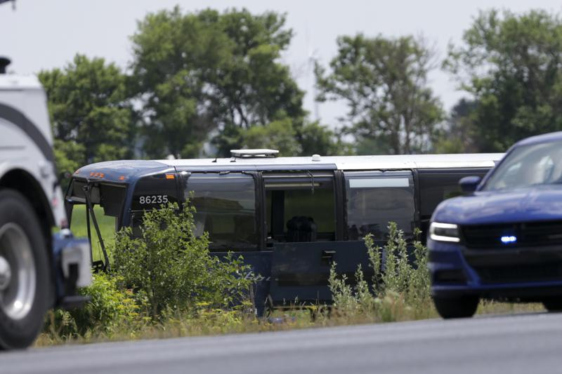Emergency crews work the scene of a fatal crash on I-65 north of Indiana 18, Friday, June 11, 2021 in Brookston, Ind. Two people were killed and several injured when an SUV collided with a Greyhound bus Friday on Interstate 65 in northwest Indiana, authorities said. (Nikos Frazier/Journal & Courier via AP)