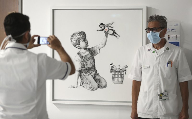 Street artist, Banksy's painting, honoring Britain's health workers in the pandemic, raises .2 million to fund health organizations and charities across the U.K.