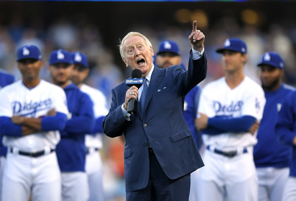 Retired Los Angeles Dodgers broadcaster Vin Scully hospitalized after falling at his Los Angeles-area home