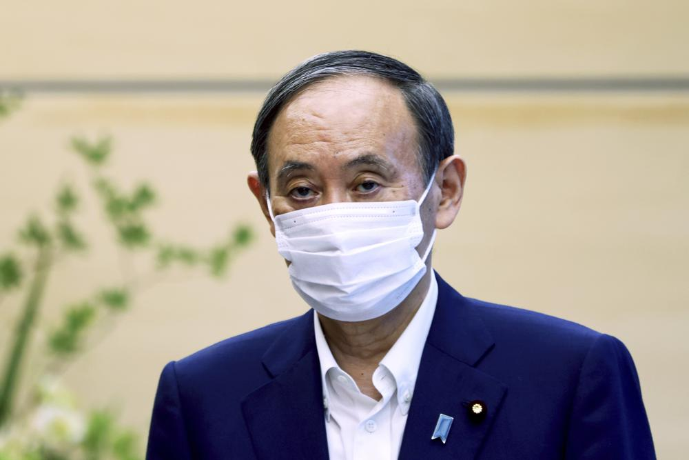 Japan's Prime Minister Yoshihide Suga to Step Down After Tumultuous Year in Office