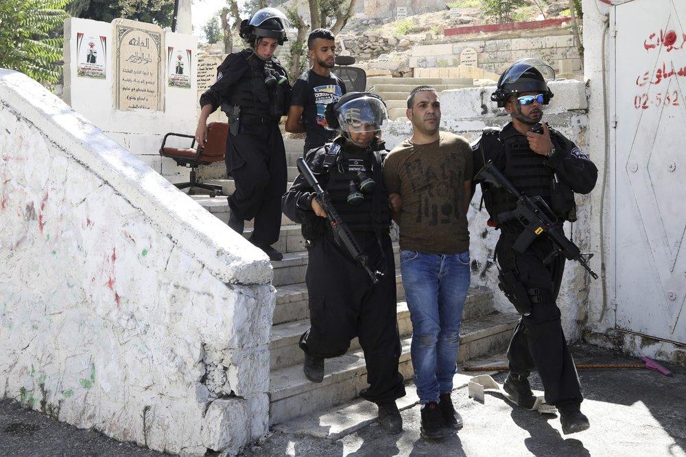 Heavy police raids leave east Jerusalem neighborhood on edge
