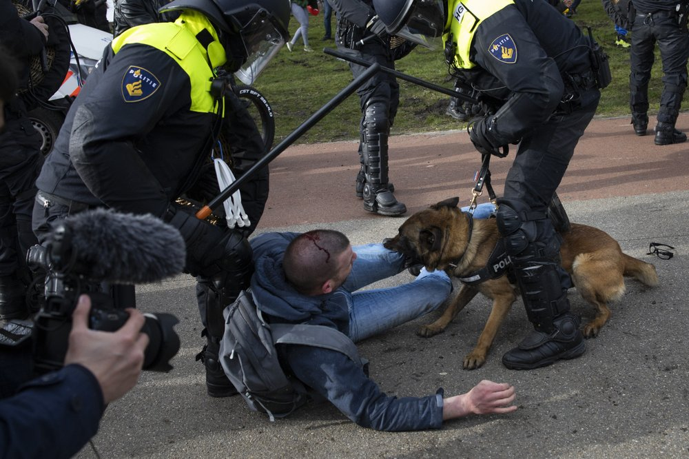 Dutch police break up anti-govt protest in The Hague on eve of election; protesters defied repeated calls to go home