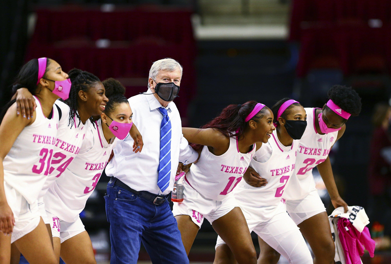 stripper m Texas basketball a womens