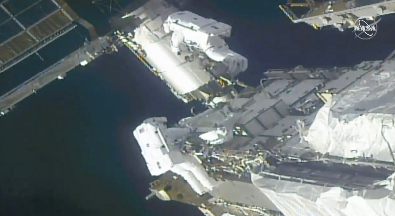 Spacewalking astronauts prepare station for new, high-efficiency solar panels