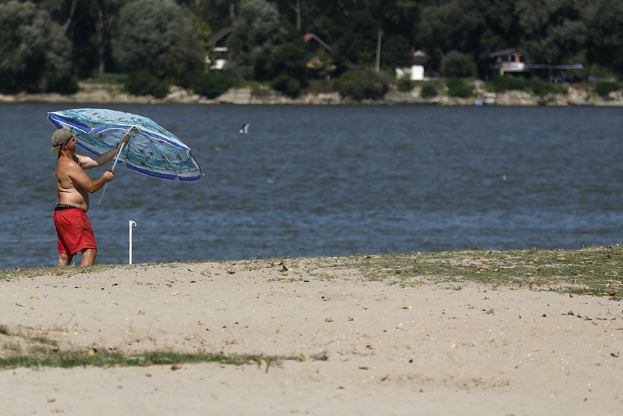 The Latest: Balkans sizzle under summer sun, warning issued