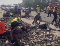 This photo provided by Tony Quinones shows the aftermath of a truck ramming into a crowd of bikers Saturday, June 19, 2021, in Show Low, Ariz. Authorities in the small city of Show Low said the unidentified 35-year-old male suspect fled the crash scene in the pickup and was shot and wounded by officers a short time later.  Of the seven cyclists hospitalized, six were in critical condition, and one was in stable condition on Sunday, June 20, 2021, police said in a statement. (Tony Quinones via AP)