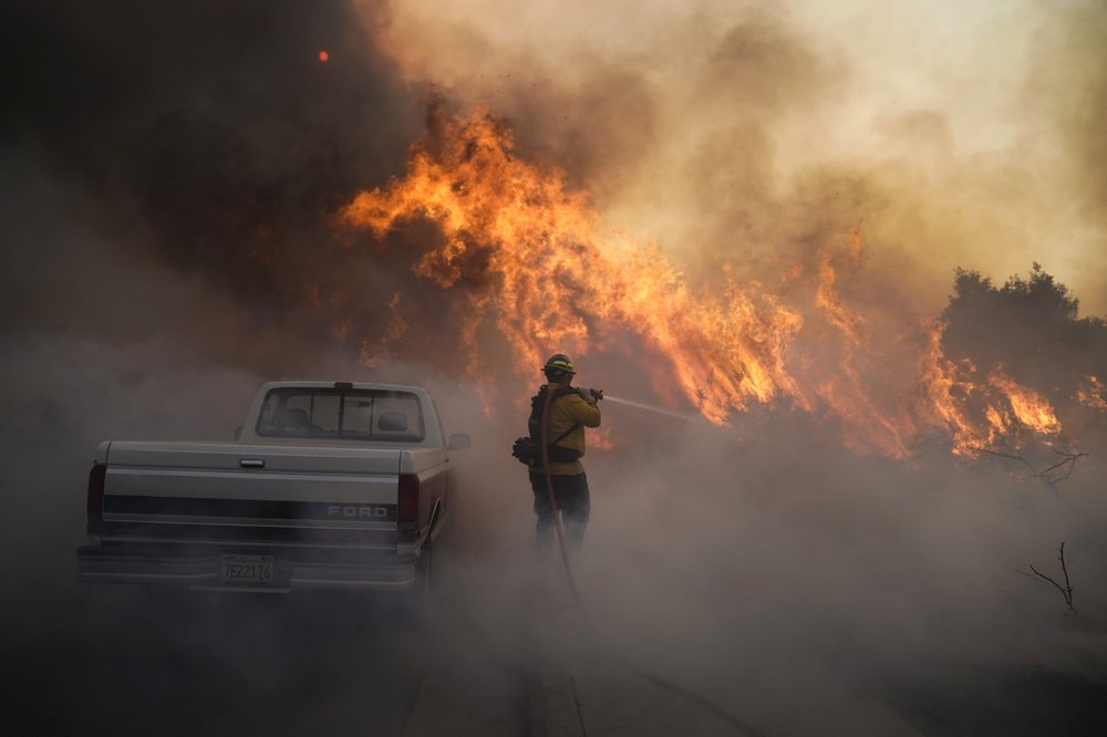 Raging California fires keep tens of thousands away from their homes