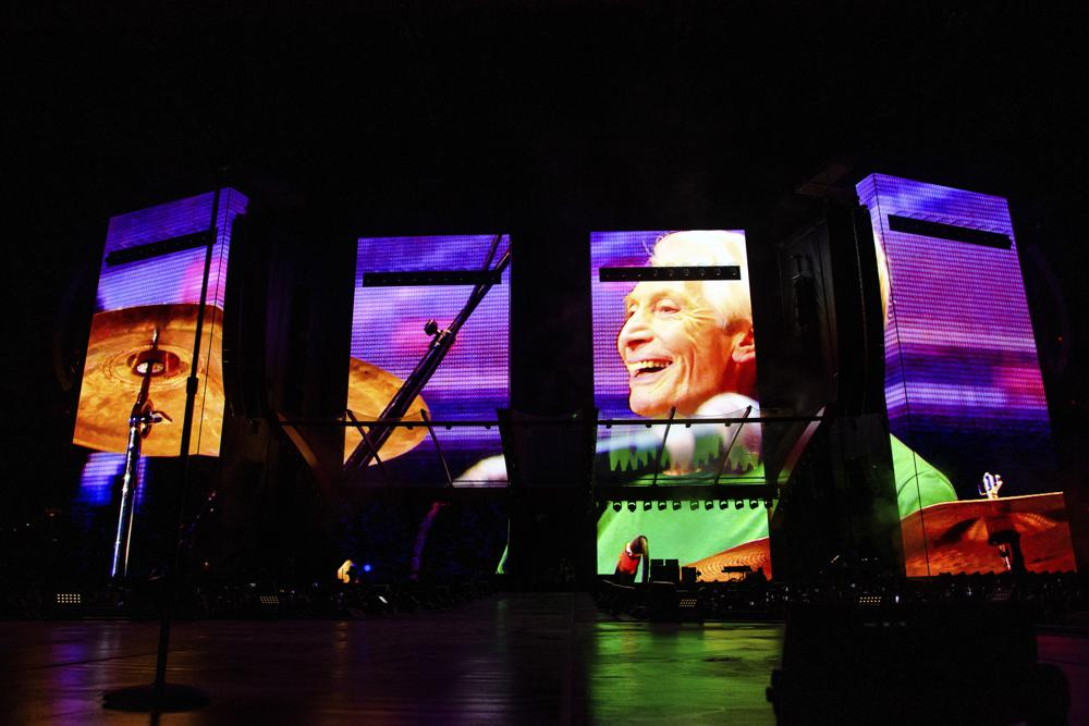 """A video tribute to Charlie Watts plays before the Rolling Stones perform during the """"No Filter"""" tour at The Dome at America's Center on Sunday, Sept. 26, 2021, in St. Louis. (Photo by Amy Harris/Invision/AP)"""