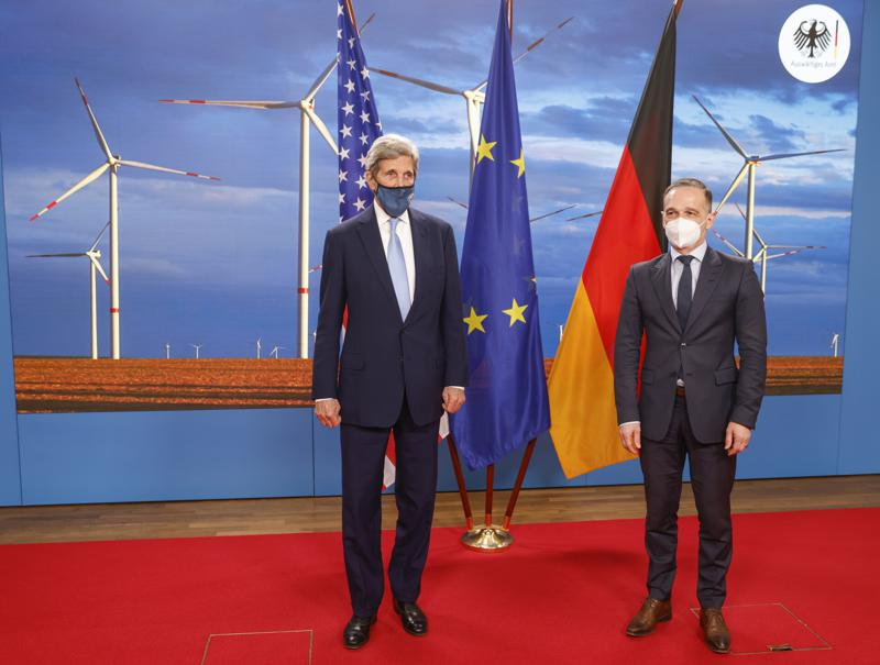 German Foreign Minister Heiko Maas, right, and the US' Special Presidential Envoy for Climate John Kerry, left, pose prior to a meeting at the Foreign Office in Berlin on Tuesday, May 18, 2021. (Odd Andersen/Pool Photo via AP)