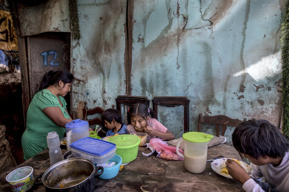 Neighbors pitch in, cook together as virus takes a toll on Latin America