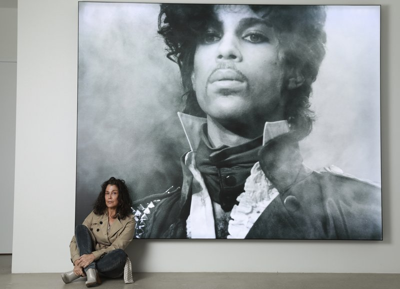 Susannah Melvoin poses next to a photo of Prince at Warner Music Group in Los Angeles on Friday, May 31, 2019. Melvoin, who recorded Prince's
