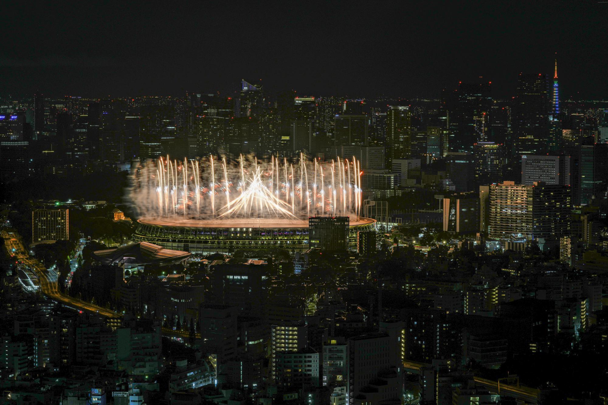 Fireworks illuminate over National Stadium during the opening ceremony of the 2020 Tokyo Olympics, Friday, July 23, 2021, in Tokyo. (AP Photo/Kiichiro Sato)