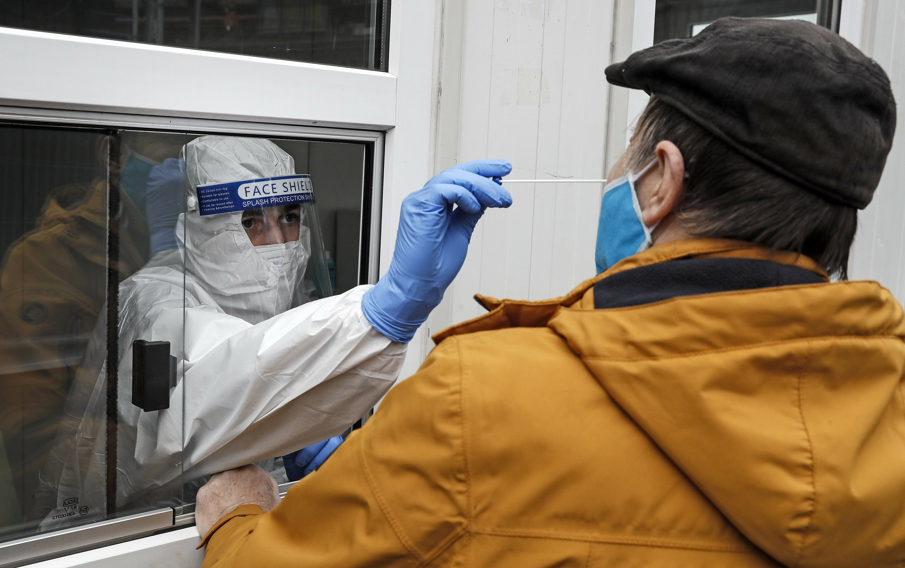 Europe reels as it sets virus records, slaps on new rules