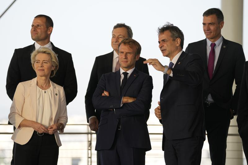 Greek Prime Minister Kyriakos Mitsotakis, right, shows the view of the Greek capital to French President Emmanuel Macron, center, European Commission President Ursula von der Leyen, left, Maltese Prime Minister Robert Abela, left background, Italian Prime Minister Mario Draghi, center background, and Spanish Prime Minister Pedro Sanchez during the EUMED 9 summit at the Stavros Niarchos Foundation Cultural Center in Athens, Friday, Sept. 17, 2021. Nine European countries on the Mediterranean are holding a summit in Athens to discuss issues ranging from climate change and the pandemic response to migration and Afghanistan. (AP Photo/Thanassis Stavrakis)