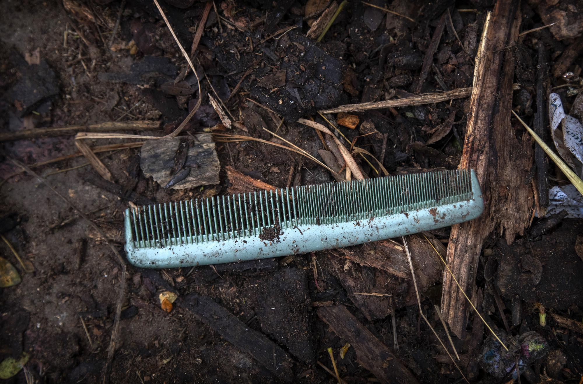 A comb of a deceased COVID-19 victim lies in a cremation ground in Gauhati, India, Friday, July 2, 2021. The personal belongings of cremated COVID-19 victims lie strewn around the grounds of the Ulubari cremation ground in Gauhati, the biggest city in India's remote northeast. It's a fundamental change from the rites and traditions that surround death in the Hindu religion. And, perhaps, also reflects the grim fears grieving people shaken by the deaths of their loved ones — have of the virus in India, where more than 405,000 people have died.