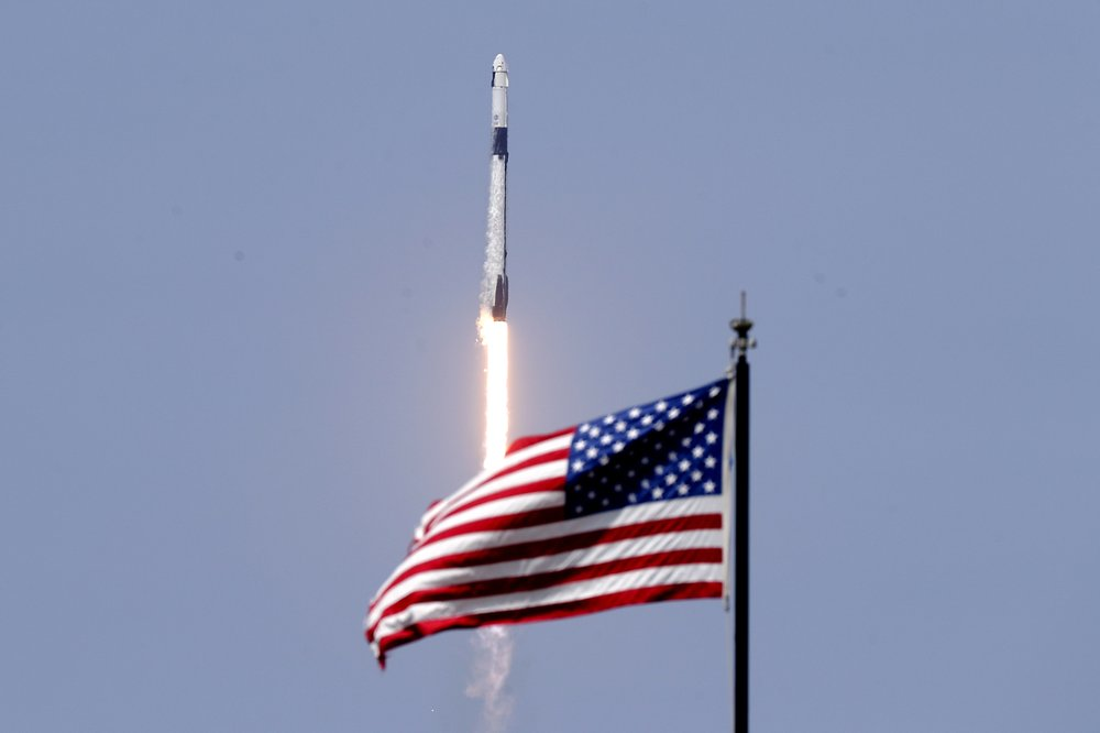 United States back in the space launching business: rocket ship built by Elon Musk's SpaceX company thundered away from Earth with two Americans