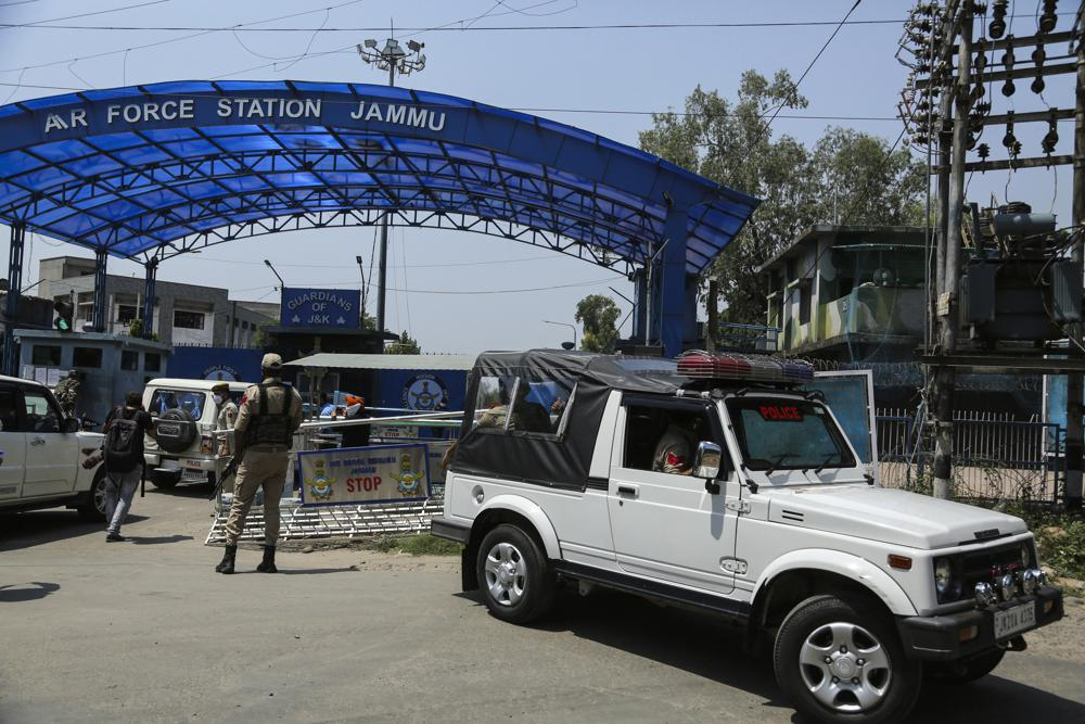 A National Investigation Agency team arrives at the Jammu air force station after two suspected blasts were reported early morning in Jammu, India, Sunday, June 27, 2021. Indian officials said Sunday they suspected explosives-laden drones were used to attack the air base in the disputed region of Kashmir, calling it the first such incident of its kind in India.