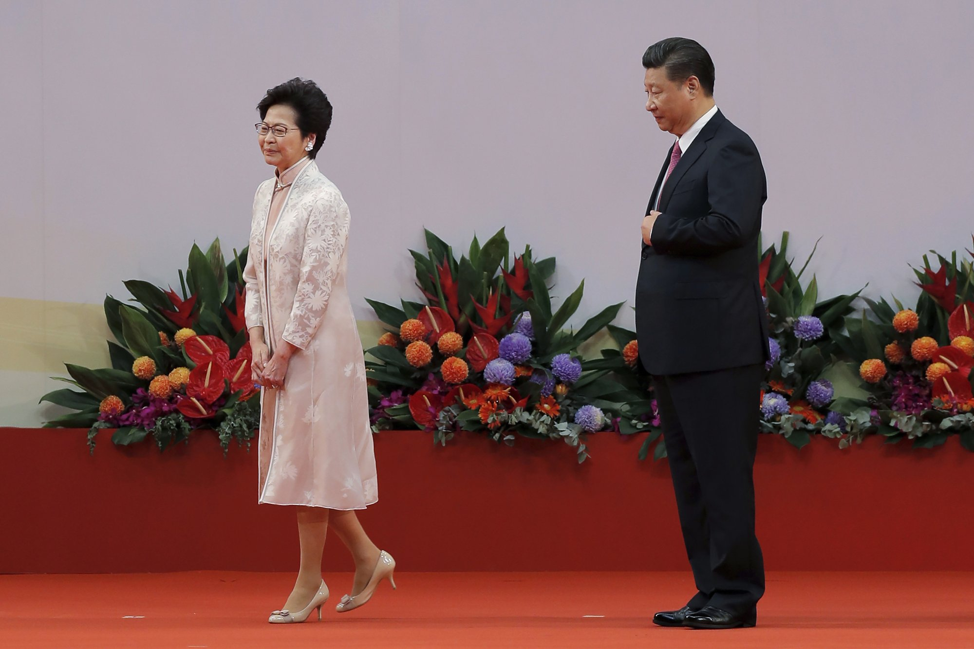 Analysis: China blinks on Hong Kong, but divide remains