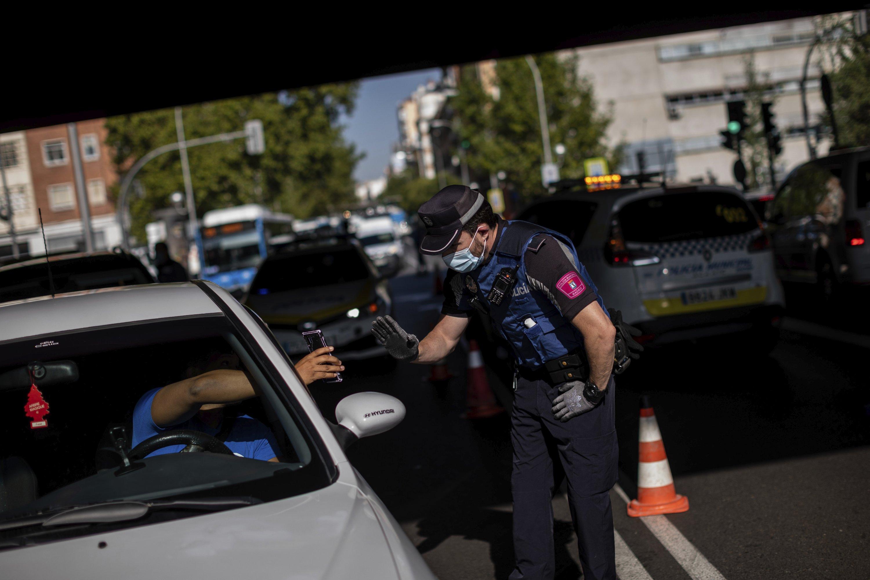 Madrid adopts virus restrictions exposing poor-rich divide