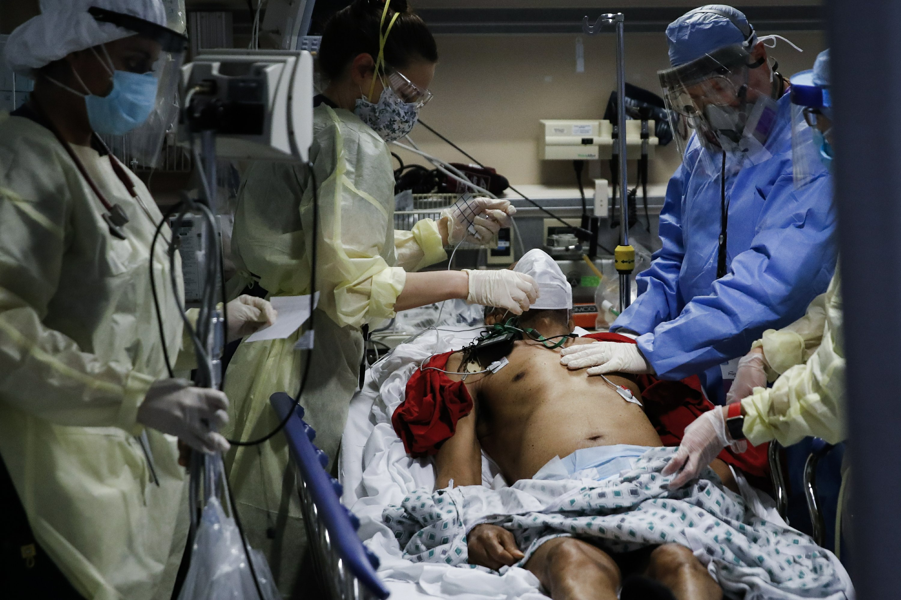 AP PHOTOS: US pandemic toll: In 1 year, half a million lives