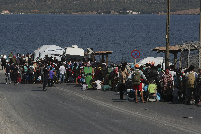 Greek police begin moving asylum-seekers into new camp