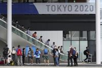 Journalists gather at Multifunctional Complex at the Tokyo 2020 Olympic and Paralympic Village during a media tour Sunday, June 20, 2021, in Tokyo. (AP Photo/Eugene Hoshiko)