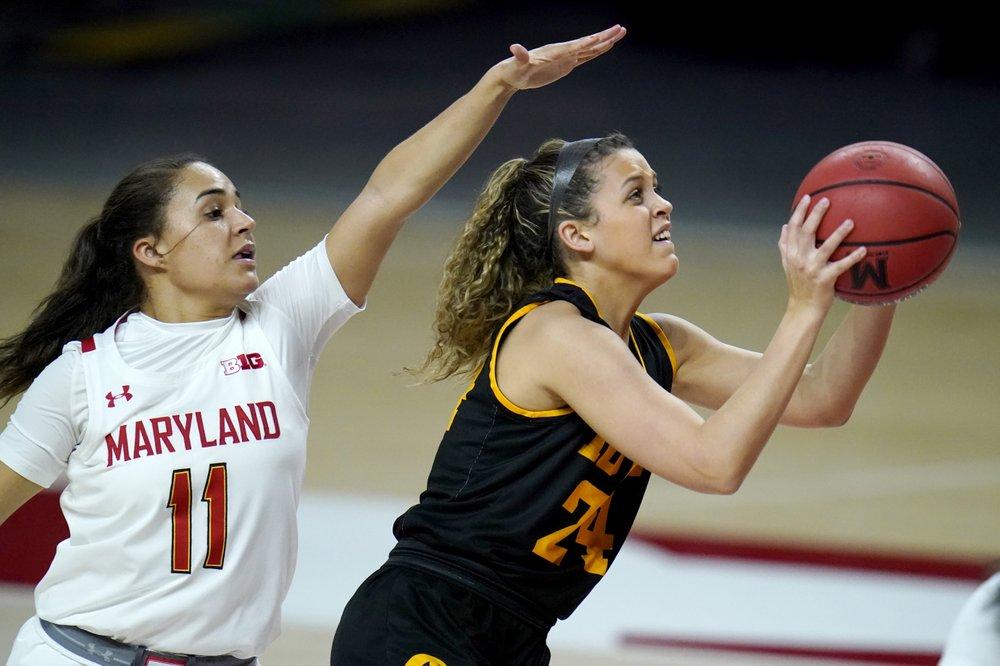 Katie Benzan leads No. 8 Maryland past Iowa 111-93