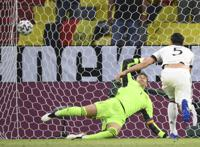 Germany's Mats Hummels, right, scores an own goal past Germany's goalkeeper Manuel Neuer during the Euro 2020 soccer championship group F match between Germany and France at the Allianz Arena stadium in Munich, Tuesday, June 15, 2021. (Franck Fife/Pool via AP)