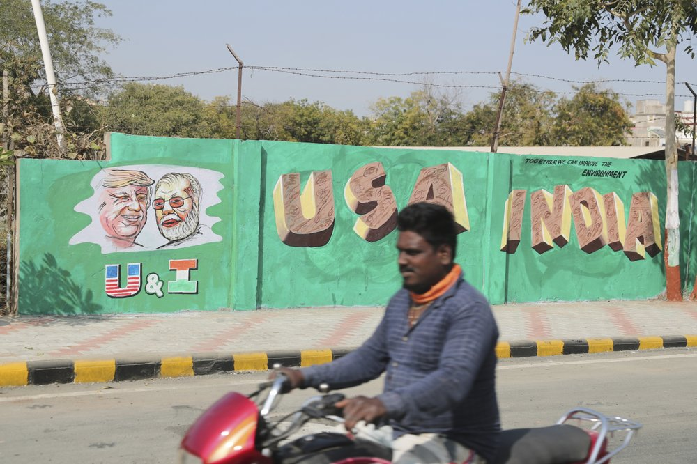 India hastily builds wall along slum ahead of Trump visit