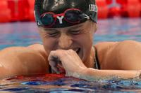 Katie Ledecky, of the United States, reacts after winning the women's 1500-meters freestyle final at the 2020 Summer Olympics, Wednesday, July 28, 2021, in Tokyo, Japan.(AP Photo/Petr David Josek)